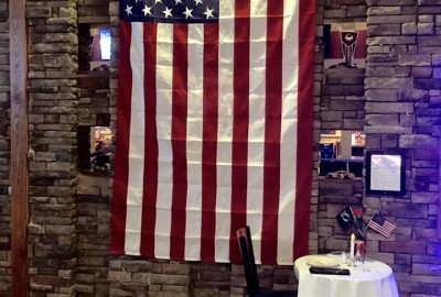 Flag at entrance to Jimmy B's paying respect to our veterans and US service personell